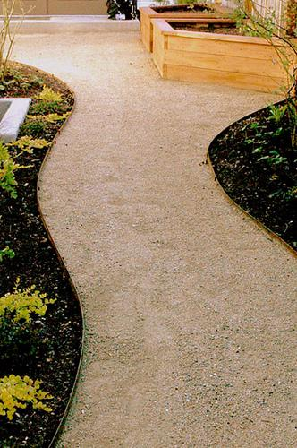 curved path with border edging keeps dark much off path