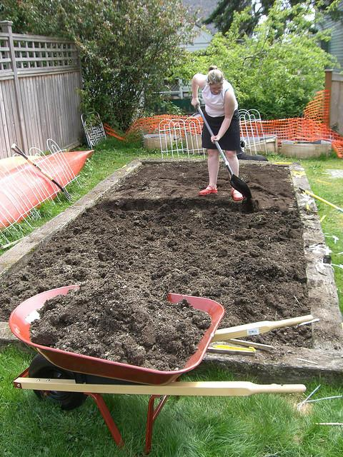 Women digging in her backyard