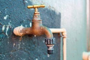 brass faucet dripping water