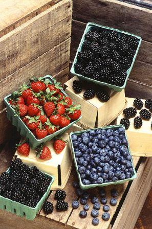 Blackberries, strawberries, and blueberries in a box